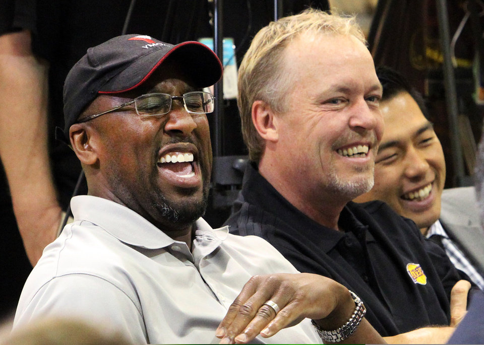 FILE - This July 11, 2012 file photo shows Los Angeles Lakers head coach Mike Brown, left, and owner Jim Buss laughing during a news conference at the basketball team's headquarters in El Segundo, Calif. A report from USA Today says the Lakers have fired Brown after a 1-4 start to his second season in charge of the team. The newspaper report Friday, Nov. 9, 2012 cited Brown's agent, Warren Legarie, as the source of the information. (AP Photo/Reed Saxon, file)
