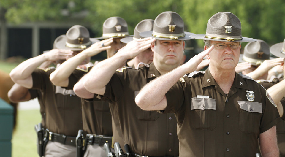 Photo - Members of The Oklahoma Highway Patrol salute during the Oklahoma Law Enforcement Officers Memorial Service in Oklahoma City , Friday May 10, 2013. Photo By Steve Gooch, The Oklahoman