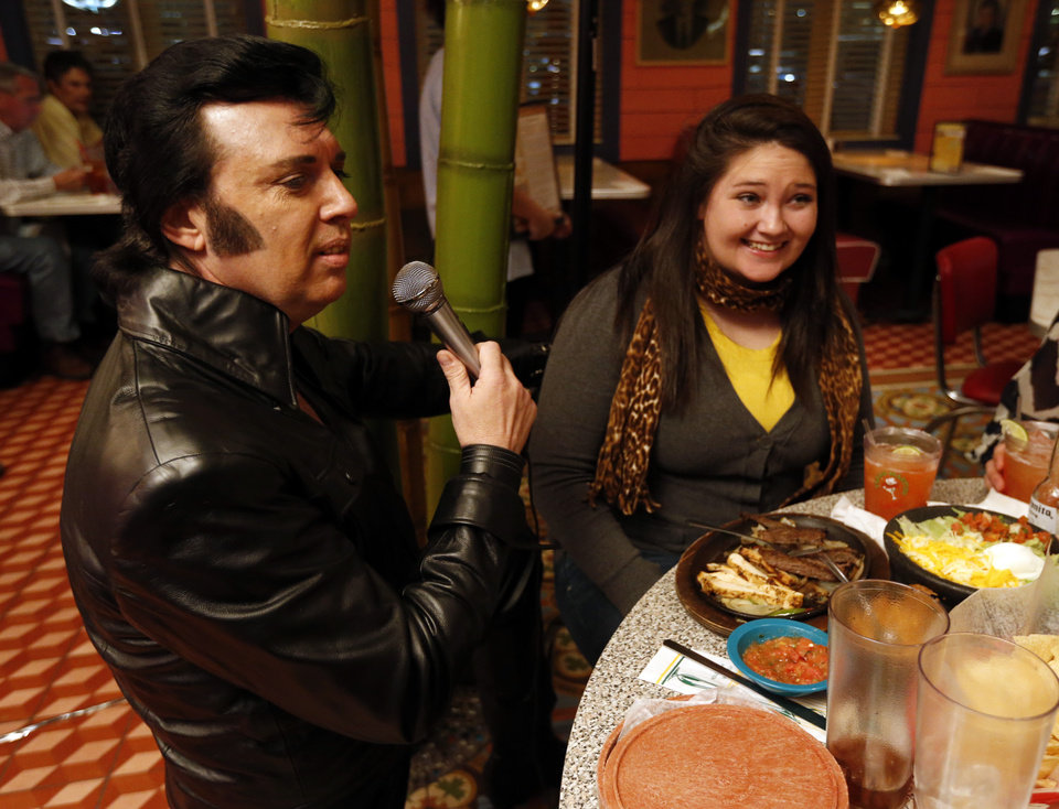Elvis Presley tribute artist Tim Keef, Lindsay, entertains people at Chuy's birthday celebration for Elvis on Wednesday, Jan. 8, 2014, in Norman.  Mustang resident Kristina Curran, just out of the Air Force is at right.  Keef is the Chief of Police of Alex, Okla.  His Leather costume was made by Elvis own costume maker, B&K Costumes of Memphis.  Photo by Steve Sisney, The Oklahoman