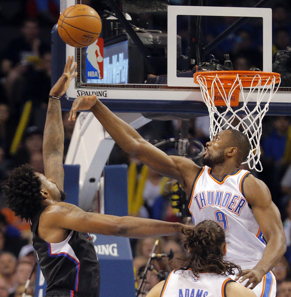 Photo - Oklahoma City's Serge Ibaka (9) defends on Los Angeles Clippers' DeAndre Jordan (6) during the NBA basketball game between the Oklahoma City Thunder and the Los Angeles Clippers at Chesapeake Energy Arena on Wednesday, March 9, 2016, in Oklahoma City, Okla. Photo by Chris Landsberger, The Oklahoman