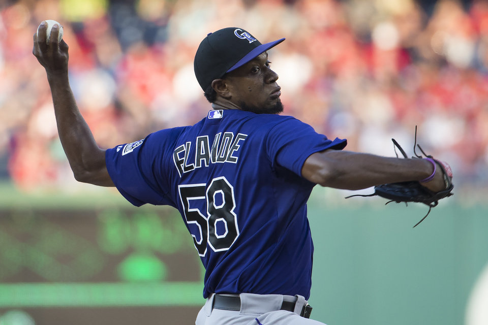 Photo - Colorado Rockies starting pitcher Yohan Flande delivers a pitch during the first inning of a baseball game against the Washington Nationals at Nationals Park, on Monday, June 30, 2014, in Washington. (AP Photo/ Evan Vucci)