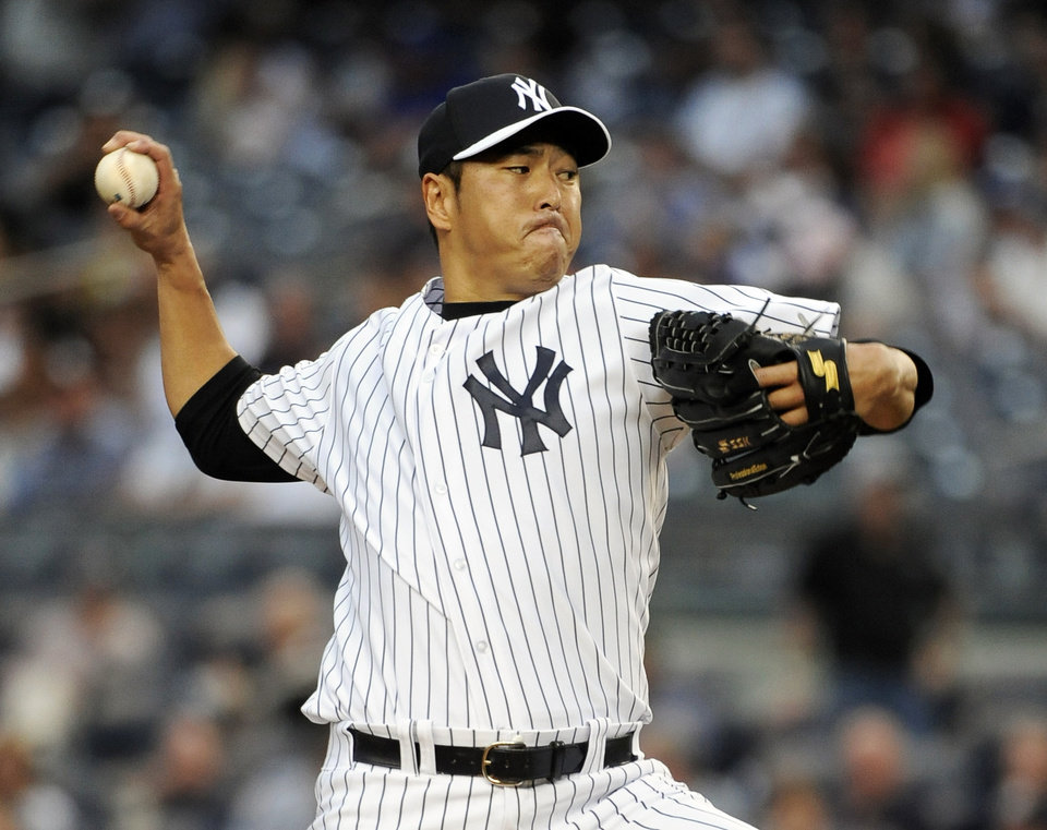 Photo - New York Yankees starting pitcher Hiroki Kuroda winds up a pitch against the New York Mets in the first inning of an interleague baseball game at Yankee Stadium on Monday, May 12, 2014, in New York. (AP Photo/Kathy Kmonicek)