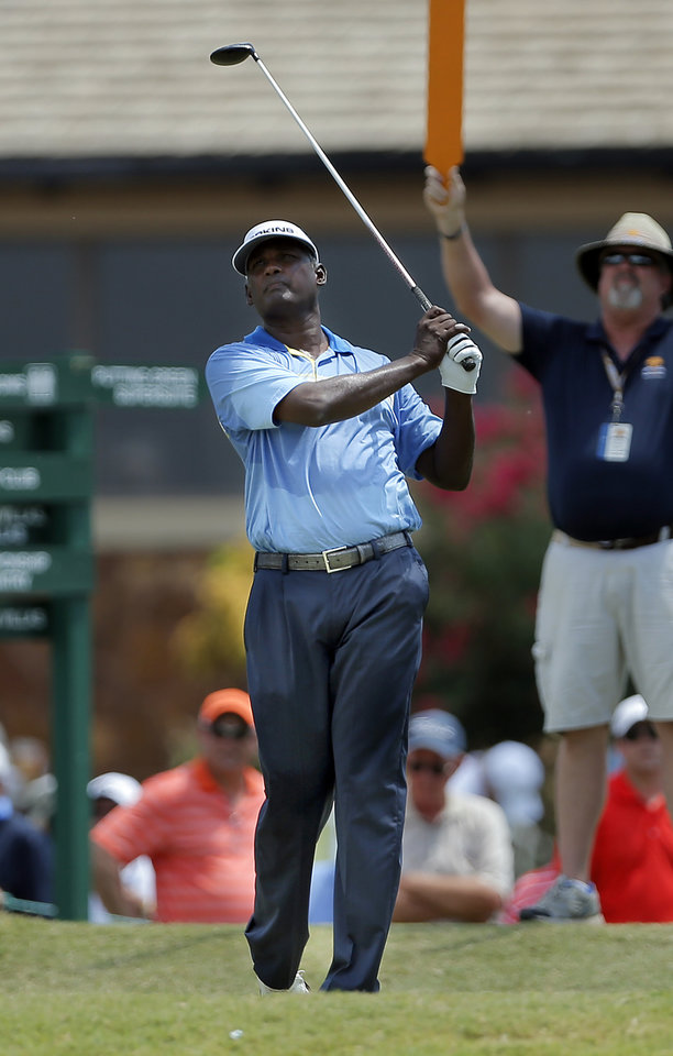 Photo - Vijay Singh watches his drive on the 10th hole the U.S. Senior Open golf tournament at Oak Tree National in Edmond, Okla., Thursday, July 10, 2014. Photo by Sarah Phipps, The Oklahoman