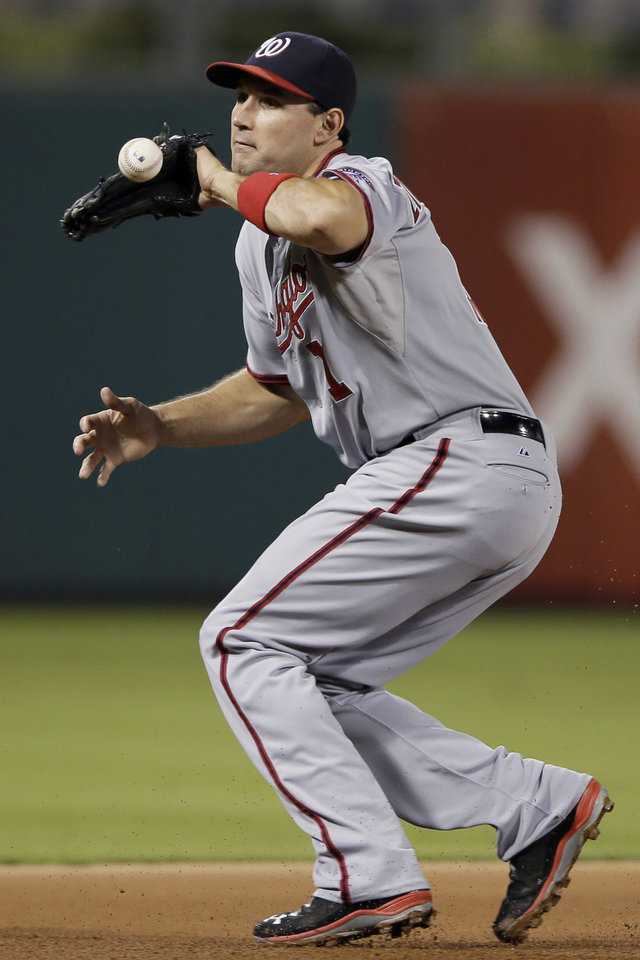 Photo - Washington Nationals third baseman Ryan Zimmerman cannot hang on to a grounder by Philadelphia Phillies' Carlos Ruiz during the fourth inning of a baseball game, Tuesday, Sept. 3, 2013, in Philadelphia. Ruiz reached first base on the error by Zimmerman. (AP Photo/Matt Slocum)