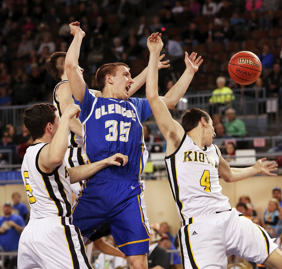 Photo - Glencoe high-scorer Ty Lazenby is surrounded by three Kiowa defenders in the lane during Class A boys high school basketball championship game in the Jim Norick Arena at State Fair Park on  Saturday, March 8, 2014. Glencoe defeated Kiowa, 57-39. Photo by Jim Beckel, The Oklahoman