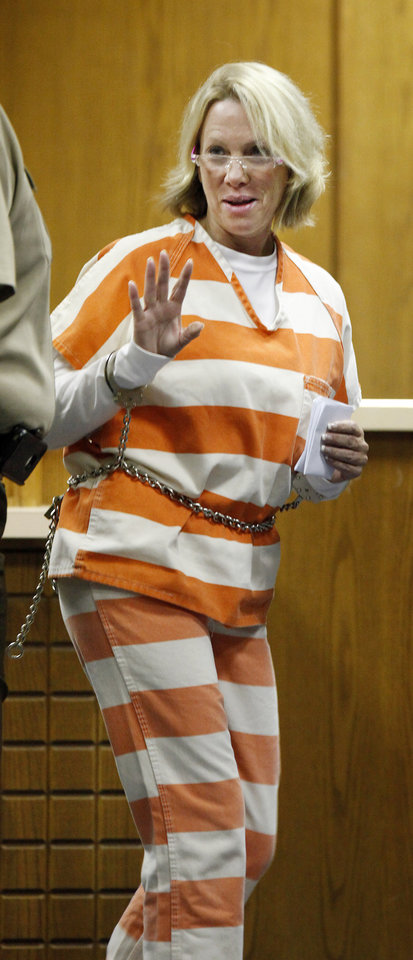 Rebecca Bryan, wife of slain fire chief Keith Bryan, waves to a family member after being arraigned at the Canadian County Courthouse in El Reno Friday, Sept. 30, 2011.Photo by Paul B. Southerland, The Oklahoman