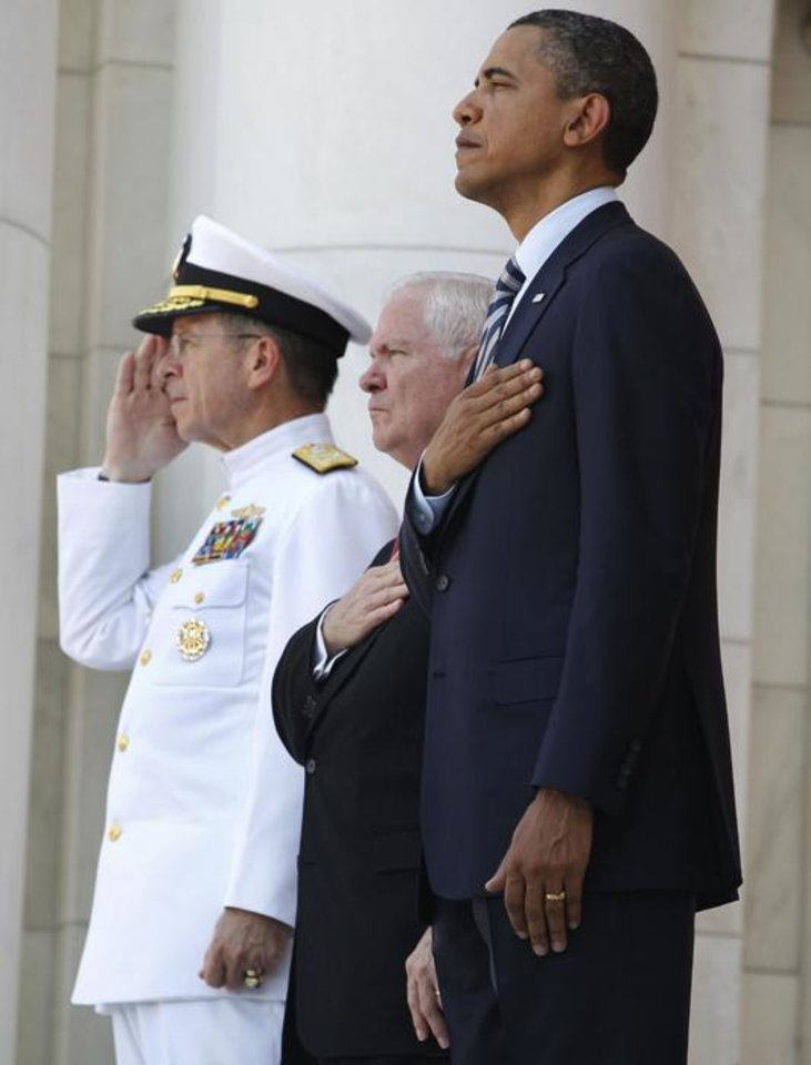 "Photo -  President Barack Obama, Defense Secretary Robert Gates, center, and Chairman of the Joint Chiefs of Staff Adm. Michael Mullen, left, are listen to the playing of ""Taps"" during a Memorial Day ceremony at Arlington National Cemetery, Monday, May 30, 2011. (AP Photo/Charles Dharapak) ORG XMIT: WHCD108"