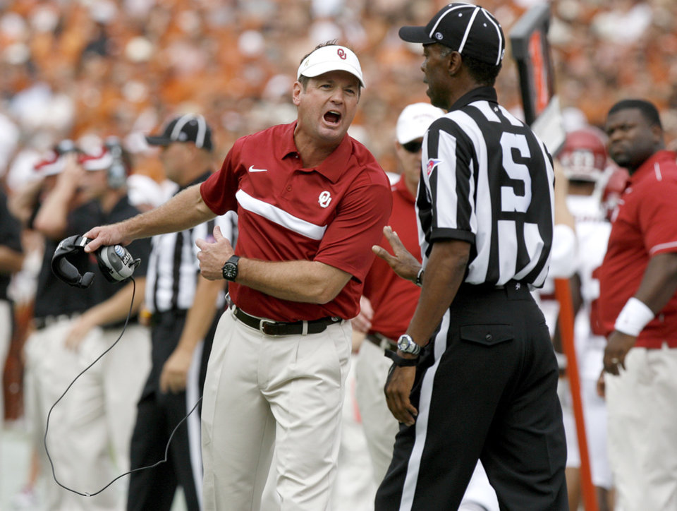 Photo - Oklahoma coach Bob Stoops reacts during the Red River Rivalry college football game between the University of Oklahoma Sooners (OU) and the University of Texas Longhorns (UT) at the Cotton Bowl in Dallas, Saturday, Oct. 8, 2011. Oklahoma won 55-17. Photo by Bryan Terry, The Oklahoman
