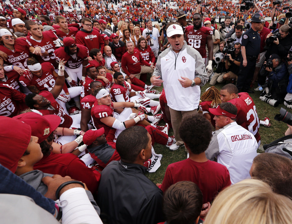 Photo - Head coach Bob Stoops and his team line up for a photograph after the Red River Showdown college football game where the University of Oklahoma Sooners (OU) defeated the University of Texas Longhorns (UT)  31-26 at the Cotton Bowl in Dallas, Texas on Saturday, Oct. 11, 2014. Photo by Steve Sisney, The Oklahoman