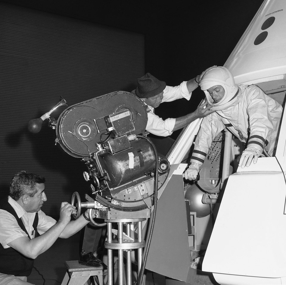 Photo -   FILE - In this June 4, 1965 file photo, from left, cameraman Sam Rosen and director Gero Nelson guide the co-star of the series