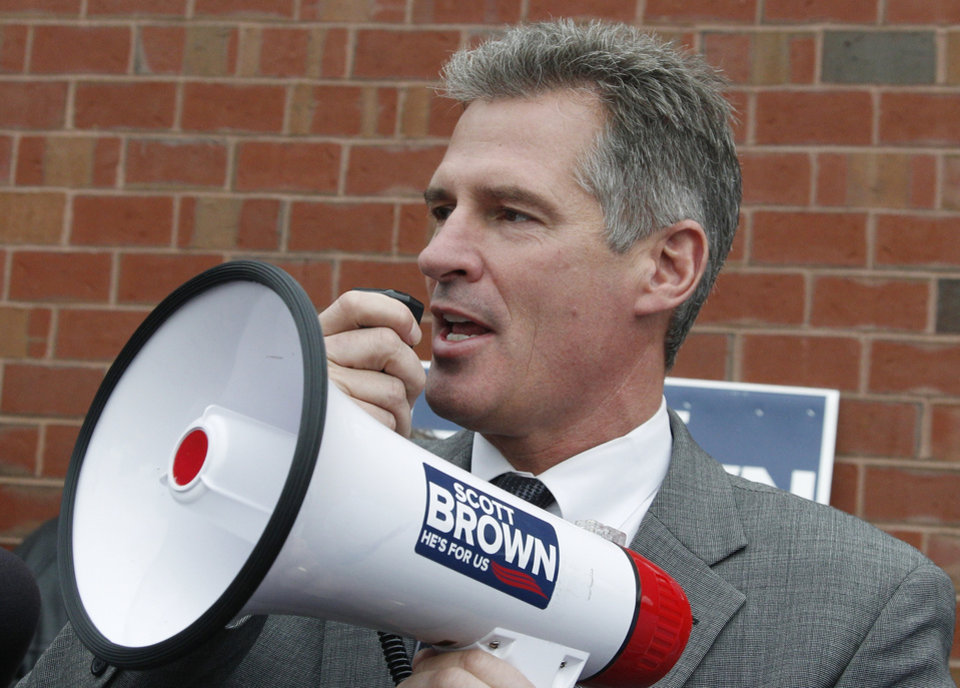 Photo - FILE - In this Oct. 24, 2012, file photo, then-Sen. Scott Brown, R-Mass., uses a bull horn at a campaign stop in Watertown, Mass. Three years ago, Brown was a little-known Republican state senator from Massachusetts who shocked Democrats by winning a U.S. Senate seat. Now, having compiled a voting record more moderate than his tea party allies would have liked and losing his bid for a full term, Brown is considering whether to seize a second chance to return to the Senate in another special election. (AP Photo/Charles Krupa, File)