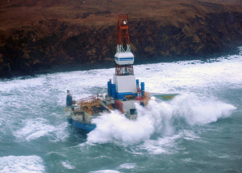 Photo - This image provided by the U.S. Coast Guard shows the Royal Dutch Shell drilling rig Kulluk aground off a small island near Kodiak Island Tuesday Jan. 1, 2013. A Coast Guard C-130 plane and a helicopter were used to fly over the grounded vessel on Tuesday morning. The severe weather did not permit putting the marine experts on board the drilling rig, which is near shore and being pounded by stormy seas. (AP Photo/U.S. Coast Guard)