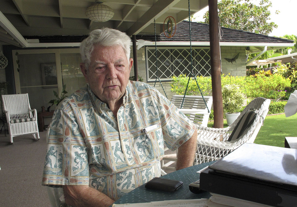 Ray Emory discusses his work pushing to change grave markers for unknown Pearl Harbor dead and identifying the remains of unknowns at his home in Honolulu on Nov. 21, 2012. The Navy and National Park Service will honor Emory on Dec. 7 for his determination to have Pearl Harbor remembered, and remembered accurately.(AP Photo/Audrey McAvoy)