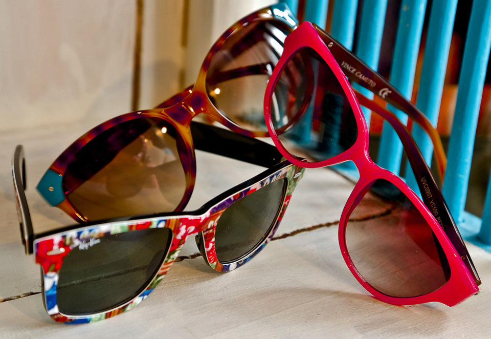 Ray-Ban printed Wayfarer, Michael Kors tortoise sunglasses with a pop of color and Vince Camuto bold pink style from Dillard\'s, Penn Square Mall. Photo by Chris Landsberger, The Oklahoman. CHRIS LANDSBERGER