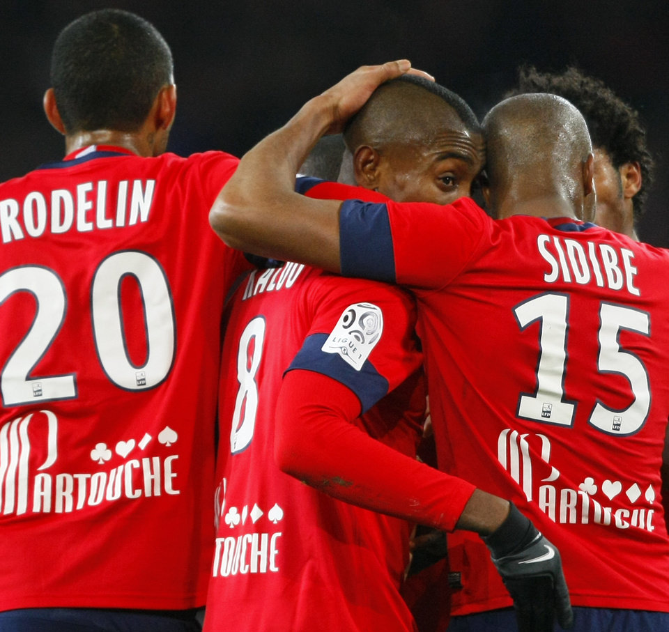 Photo - Lille's Salomon Kalou, center, is congratulated by teammates after he scored during their French League one soccer match against Rennes  at the Lille Metropole stadium, in Villeneuve d'Ascq, northern France, Friday, Jan. 24, 2014. (AP Photo/Michel Spingler)