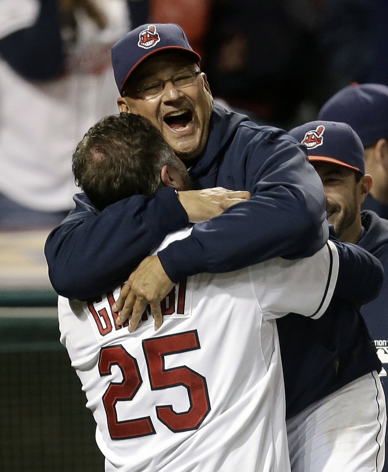 Photo - FILE - In this Sept. 24, 2013, file photo, Cleveland Indians designated hitter Jason Giambi, left, picks up manager Terry Francona after Giambi hit a two-run home run off Chicago White Sox relief pitcher Addison Reed in the ninth inning of a baseball game in Cleveland. Francona was selected as the AL Manager of the Year on Tuesday, Nov. 12, 2013, by the Baseball Writers' Association of America. (AP Photo/Tony Dejak, File)