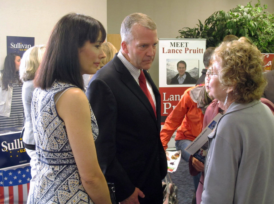 Photo - Republican U.S. Senate hopeful Dan Sullivan and his wife, Julie Fate Sullivan, left, speak to a woman during