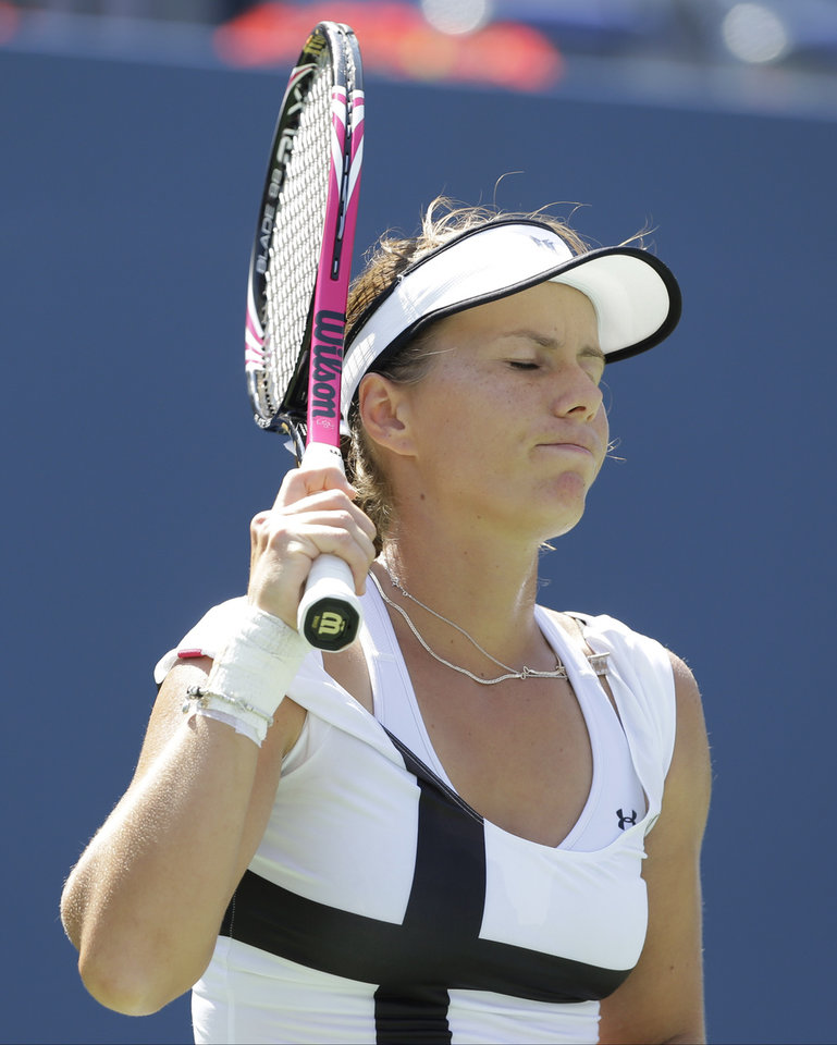 Photo -   Varvara Lepchenko reacts during her match against Samantha Stosur, of Australia, in the third round of play at the 2012 US Open tennis tournament, Friday, Aug. 31, 2012, in New York. (AP Photo/Mike Groll)