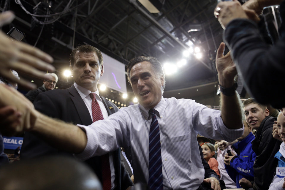 Photo -   Republican presidential candidate and former Massachusetts Gov. Mitt Romney greets supporters at a New Hampshire campaign rally at Verizon Wireless Arena in Manchester, N.H., Monday, Nov. 5, 2012. (AP Photo/Charles Dharapak)