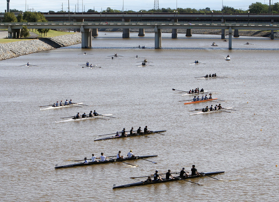 Rowers move their rowing shells toward the start line during the Oklahoma Regatta Festival on the Oklahoma River in Oklahoma City, OK, Saturday, October 5, 2013, Photo by Paul Hellstern, The Oklahoman