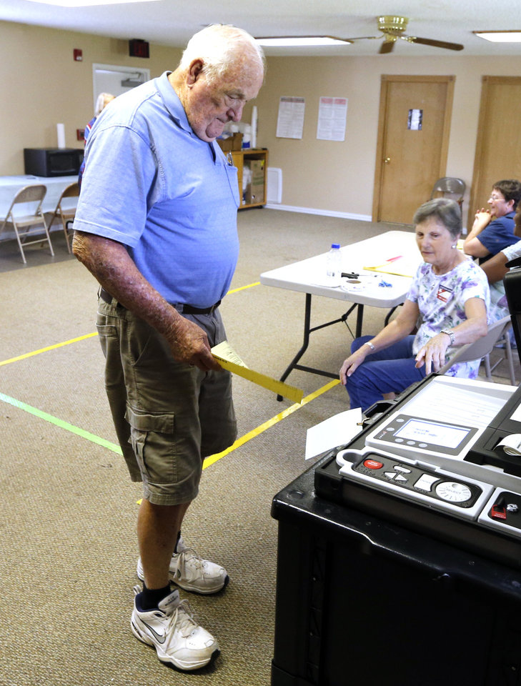 Photo - Marvin Hawkins casts his ballot in Cleveland County Precinct 25 in Norman, Okla., on Tuesday, June 28, 2016. Photo by Steve Sisney, The Oklahoman