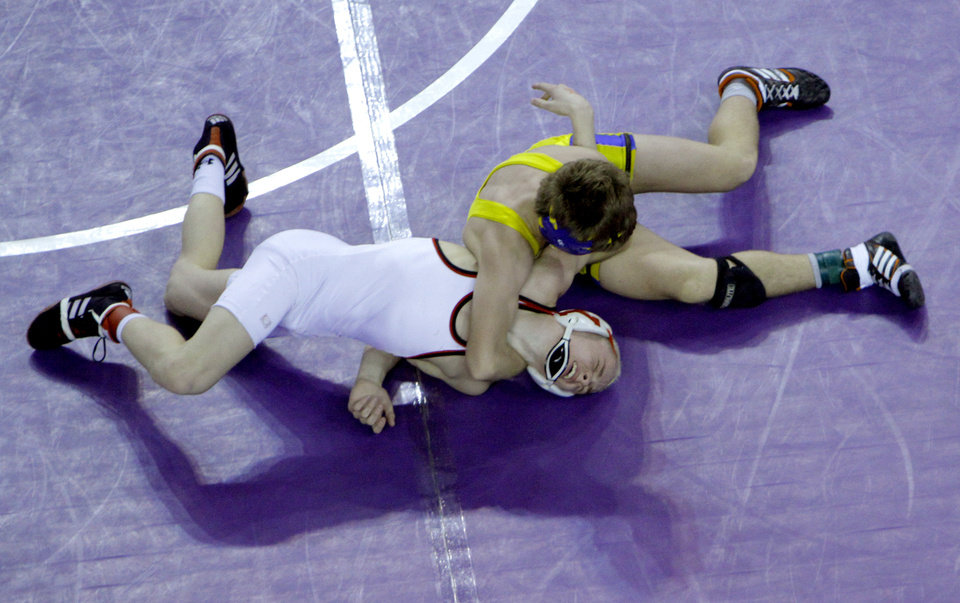 Stillwater\'s Joe Smith wrestles Boo Lewallen following the Class 6A 113-pound match during the state wrestling championships at the State Fair Arena in Oklahoma City, Saturday, Feb. 25, 2012. Photo by Sarah Phipps, The Oklahoman