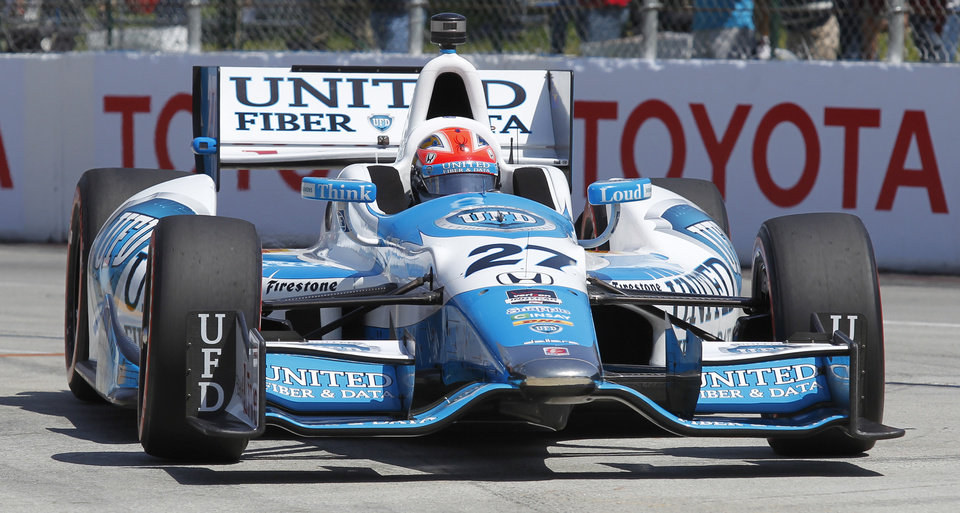 Photo - James Hinchcliffe comes into the pit during the IndyCar qualifying in the Grand Prix of Long Beach auto race on Saturday, April 12, 2014, in Long Beach, Calif. (AP Photo/Alex Gallardo)
