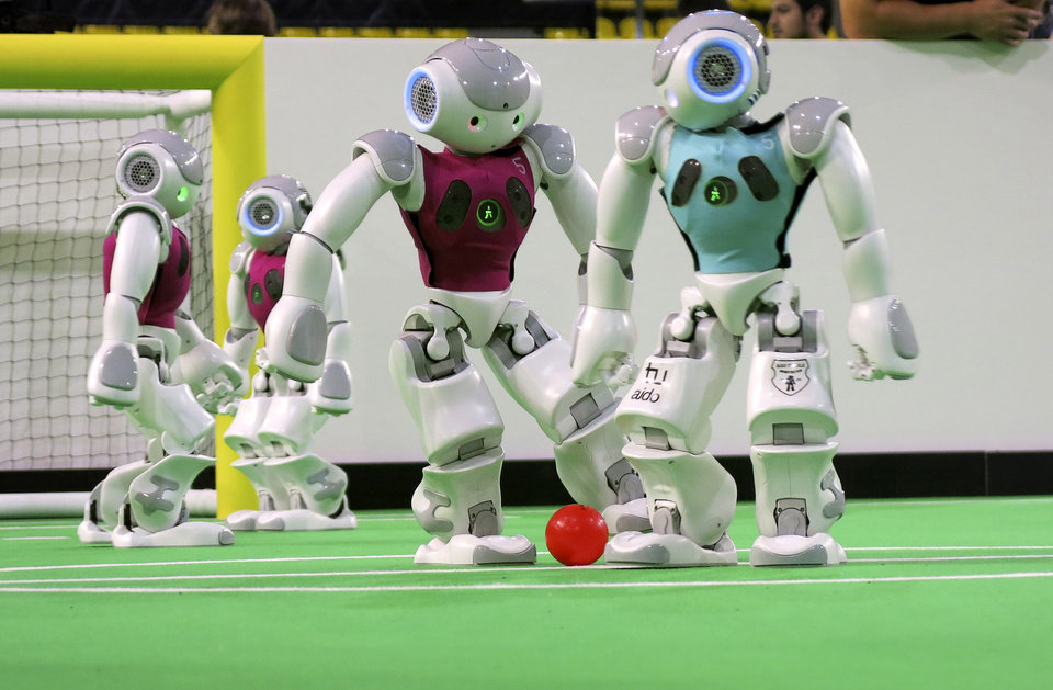 Photo - In this photo taken Thursday, June 27, 2013 robots in the