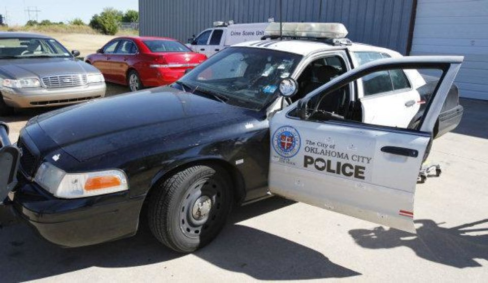 Photo - This is the police car of the Oklahoma City police officer who was ambushed and shot multiple times after a Sunday night traffic stop. By Paul Hellstern, The Oklahoman ORG XMIT: KOD  PAUL HELLSTERN