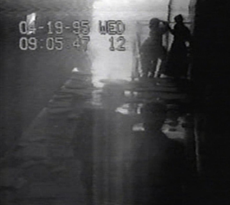 Photo - ALFRED P. MURRAH FEDERAL BUILDING, CAR, TRUCK, BOMB, EXPLOSION / VIDEO CLIP / SCREEN SHOT / VIDEO SURVEILLANCE CAMERA FOOTAGE: This image is from a Southwestern Bell security camera that recorded people fleeing the building in the seconds after the Oklahoma City bombing. The time on the first image is slightly behind the established time of the explosion — 9:02 a.m., April 19, 1995. 	IMAGES PROVIDED BY JESSE TRENTADUE    ORG XMIT: 0909260313110789