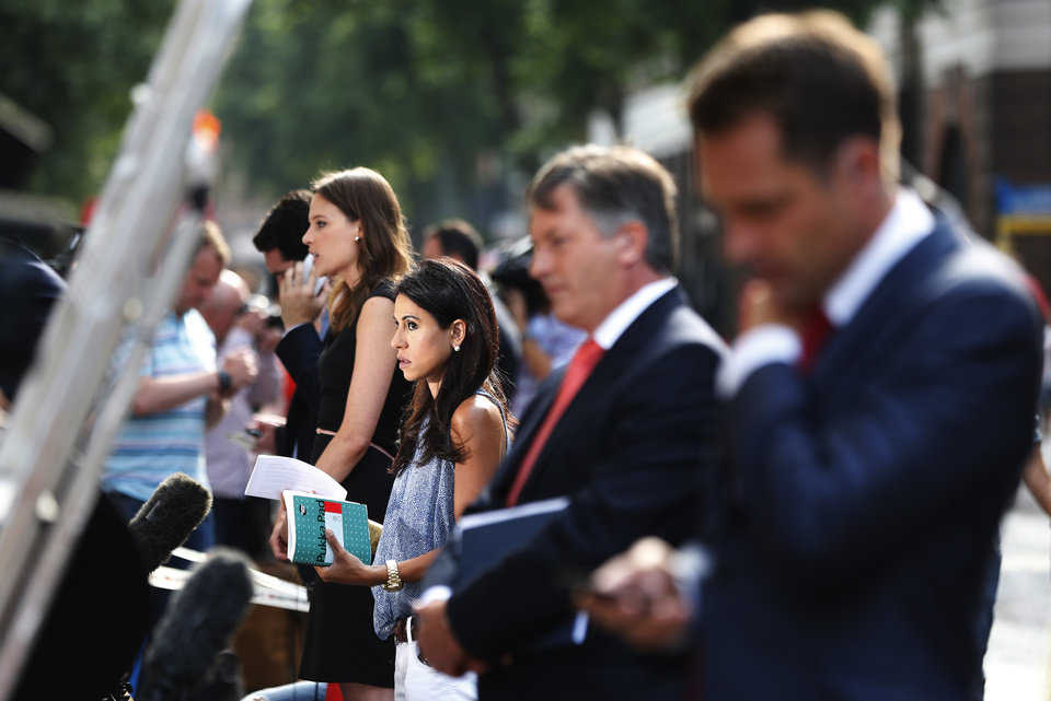 Photo - Members of broadcast media give live reports across St. Mary's Hospital exclusive Lindo Wing in London, Monday, July 22, 2013. Buckingham Palace officials say Prince William's wife,  Kate, has been admitted to the hospital in the early stages of labour. Royal officials said that Kate traveled by car to St. Mary's Hospital in central London. Kate _ also known as the Duchess of Cambridge _ is expected to give birth in the private Lindo Wing of the hospital, where Princess Diana gave birth to William and his younger brother, Prince Harry.The baby will be third in line for the British throne _ behind Prince Charles and William _ and is anticipated eventually to become king or queen. (AP Photo/Lefteris Pitarakis)