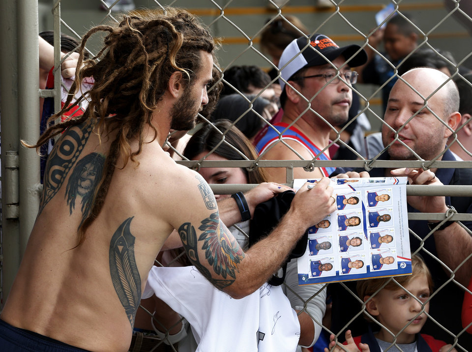 Photo - United States' Kyle Beckerman signs autographs following a training session at the Sao Paulo FC training center in Sao Paulo, Brazil, Wednesday, June 11, 2014. The U.S. will play in group G of the 2014 soccer World Cup. (AP Photo/Julio Cortez)