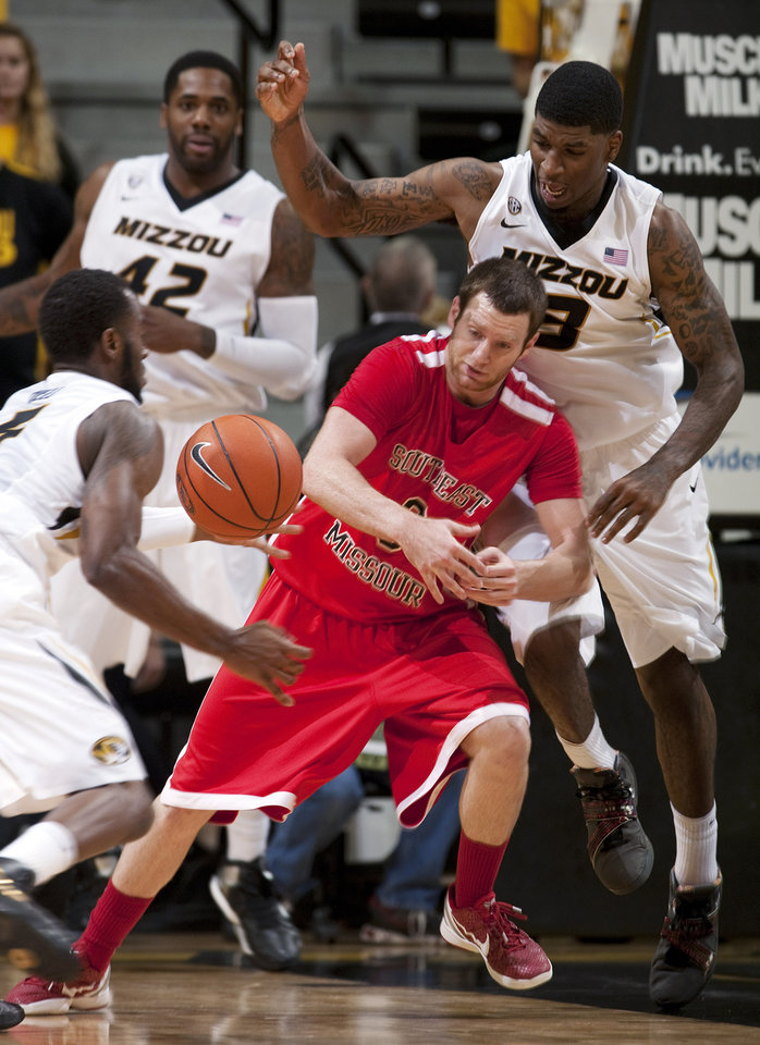 Southeast Missouri State's Nick Niemczyk, center, loses control of the ball between Missouri's Tony Criswell, right, Keion Bell, left front, and Alex Oriakhi, back, during the second half of an NCAA college basketball game Tuesday, Dec. 4, 2012, in Columbia, Mo. Missouri won 81-65. (AP Photo/L.G. Patterson)