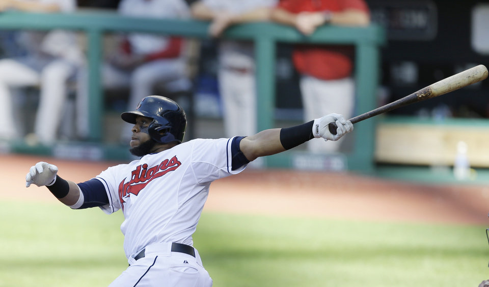 Photo - Cleveland Indians' Carlos Santana hits a double off Arizona Diamondbacks starting pitcher Vidal Nuno in the sixth inning of the first baseball game of a doubleheader, Wednesday, Aug. 13, 2014, in Cleveland. (AP Photo/Tony Dejak)