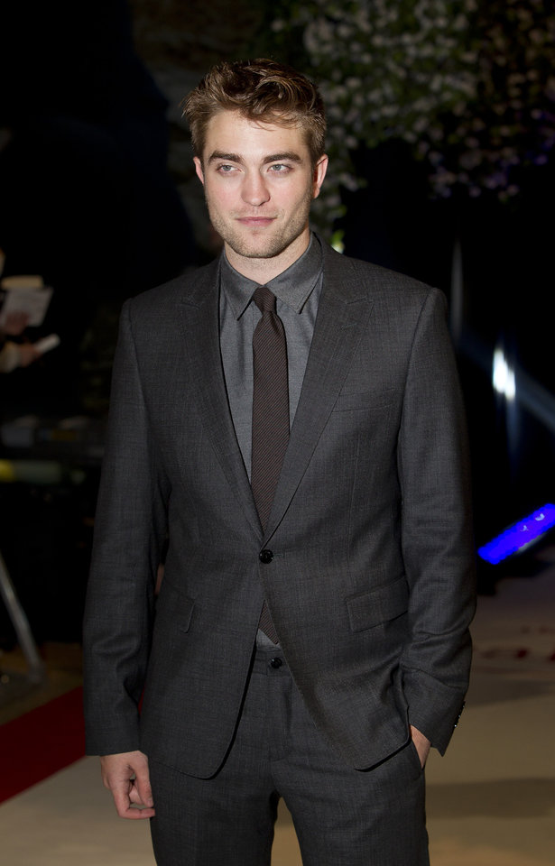 British actor Robert Pattinson arrives for the UK film premiere of 'Twilight Breaking Dawn Part 1' at Westfield Stratford in east London, Wednesday, Nov. 16, 2011. (AP Photo/Joel Ryan) ORG XMIT: LENT113