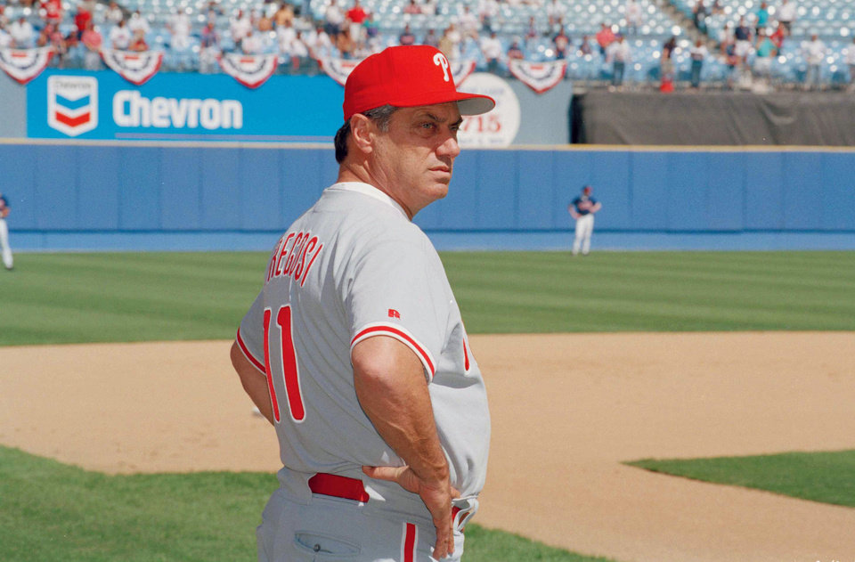 Photo - FILE - In this Oct. 9, 1993 file photo, Philadelphia Phillies manger Jim Fregosi watches during batting practice before the start of game 3 of the NLCS in Atlanta. Fregosi, a former All-Star who won more than 1,000 games as a manager for four teams, has died after an apparent stroke. He was 71. The Atlanta Braves say they were notified by a family member that died early Friday, Feb. 14, 2014,  in Miami, where he was hospitalized after the apparent stroke while on a cruise with baseball alumni.  (AP Photo/Ed Reinke)