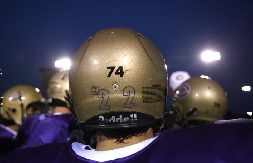 Wearing a No. 74 on his helmet, Skylar McKinney huddles before the football game between Chickasha and Capitol Hill at Chickasha High School, Friday, Oct. 1, 2010. It was the first home game since the death of player Kody Turner. Photo by Sarah Phipps, The Oklahoman
