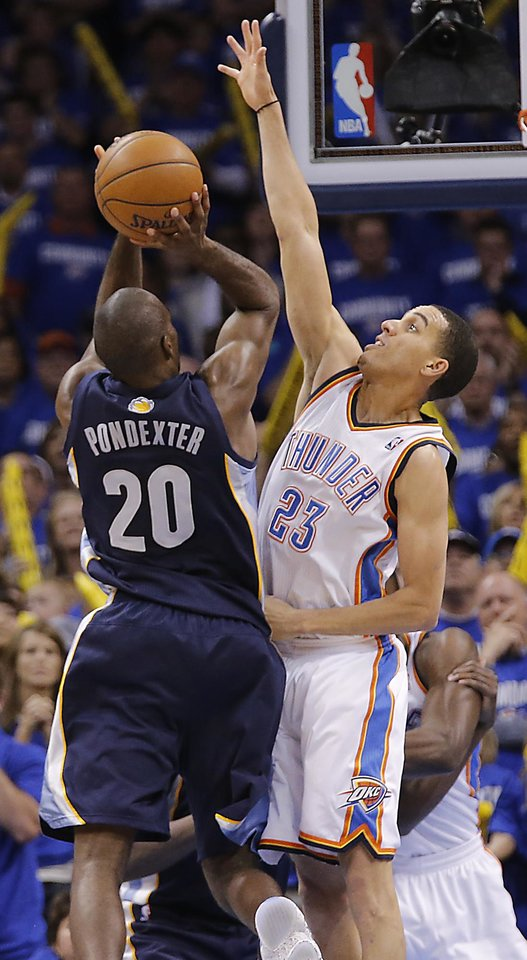 Photo - Oklahoma City's Kevin Martin (23) blocks a shot by Memphis' Quincy Pondexter (20) during the second round NBA playoff basketball game between the Oklahoma City Thunder and the Memphis Grizzlies at Chesapeake Energy Arena in Oklahoma City, Sunday, May 5, 2013. Photo by Chris Landsberger, The Oklahoman