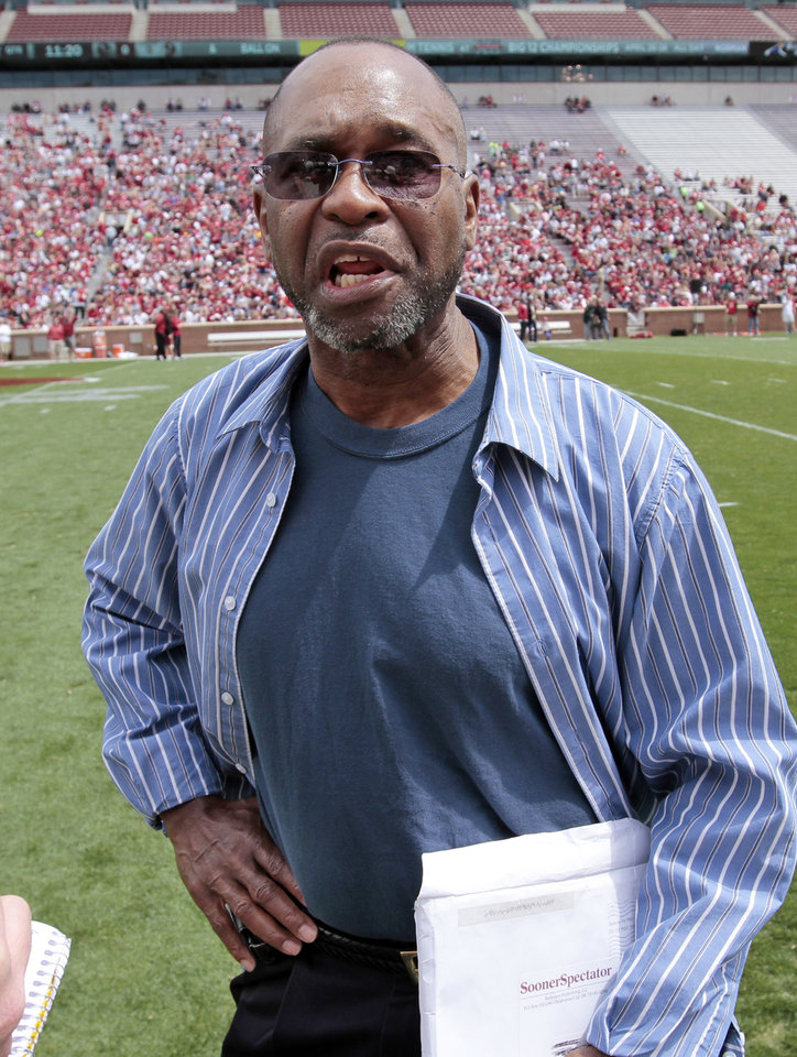 Photo - Former player Glenn King speaks with a reporter before the annual Spring Football Game at Gaylord Family-Oklahoma Memorial Stadium in Norman, Okla., on Saturday, April 13, 2013. Photo by Steve Sisney, The Oklahoman