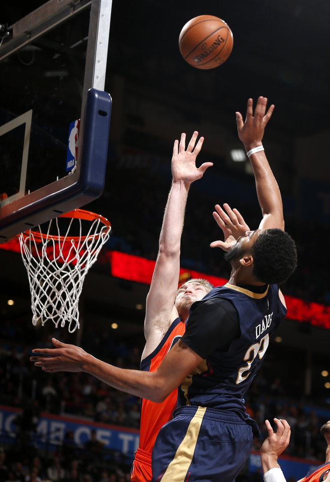 Photo - New Orleans' Anthony Davis (23) shoots over Oklahoma City's Domantas Sabonis (3) during the NBA game between the Oklahoma City Thunder and the New Orleans Pelicans at the Chesapeake Energy Arena,  Sunday, Dec. 4, 2016. Photo by Sarah Phipps, The Oklahoman