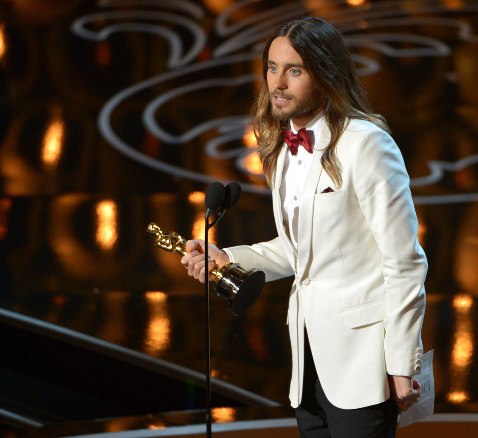 """Photo - Jared Leto accepts the award for best actor in a supporting role for """"Dallas Buyers Club"""" during the Oscars at the Dolby Theatre on Sunday, March 2, 2014, in Los Angeles.  (Photo by John Shearer/Invision/AP)"""