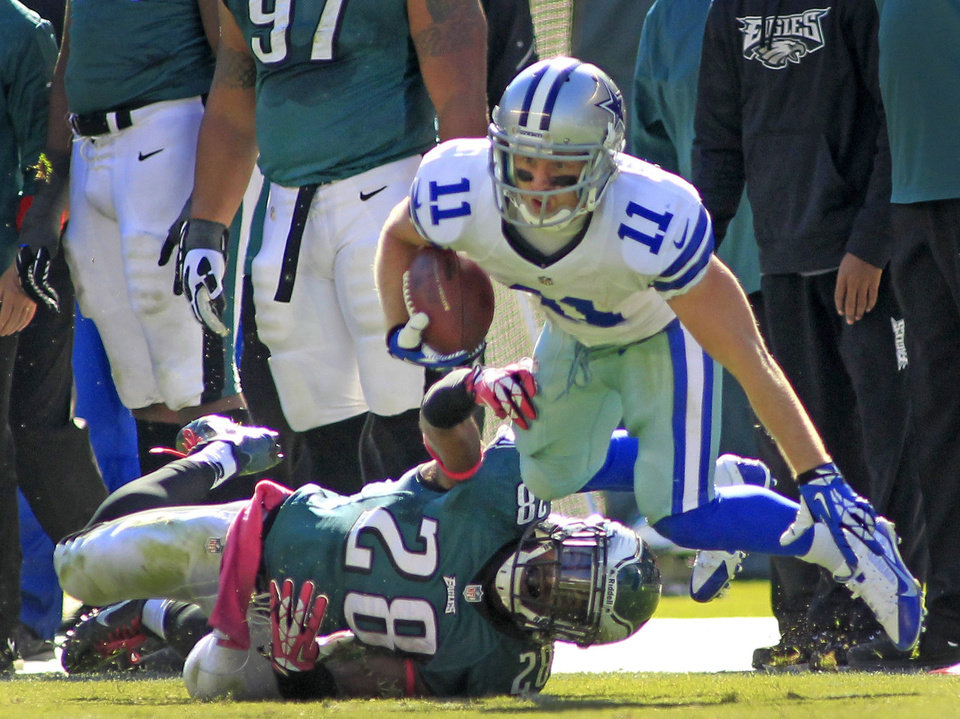 Dallas wide receiver Cole Beasley tries to escape a tackle by Eagles free safety Earl Wolff on Sunday.  Photo by Paul Moseley, Fort Worth Star-Telegram/MCT