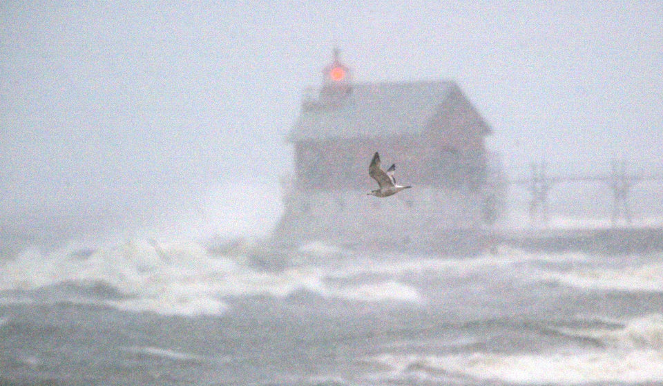 A lone gull attempts to fly against the wind blowing over the Lake Michigan surf  close to the Grand Haven, Mich.  pier on Tuesday, March 19, 2013. A late winter storm is dumping snow on Michigan's Upper Peninsula, with up to 2 feet forecast in places.   Heavy lake-effect snow is expected along Lake Superior. Occasional white-out conditions are forecast into Wednesday. In parts of the northern Lower Peninsula, 6 to 9 inches of snow is forecast by Thursday morning. Some areas could see more than a foot. (AP Photo/The Muskegon Chronicle, ) ALL LOCAL TV OUT; LOCAL TV INTERNET OUT