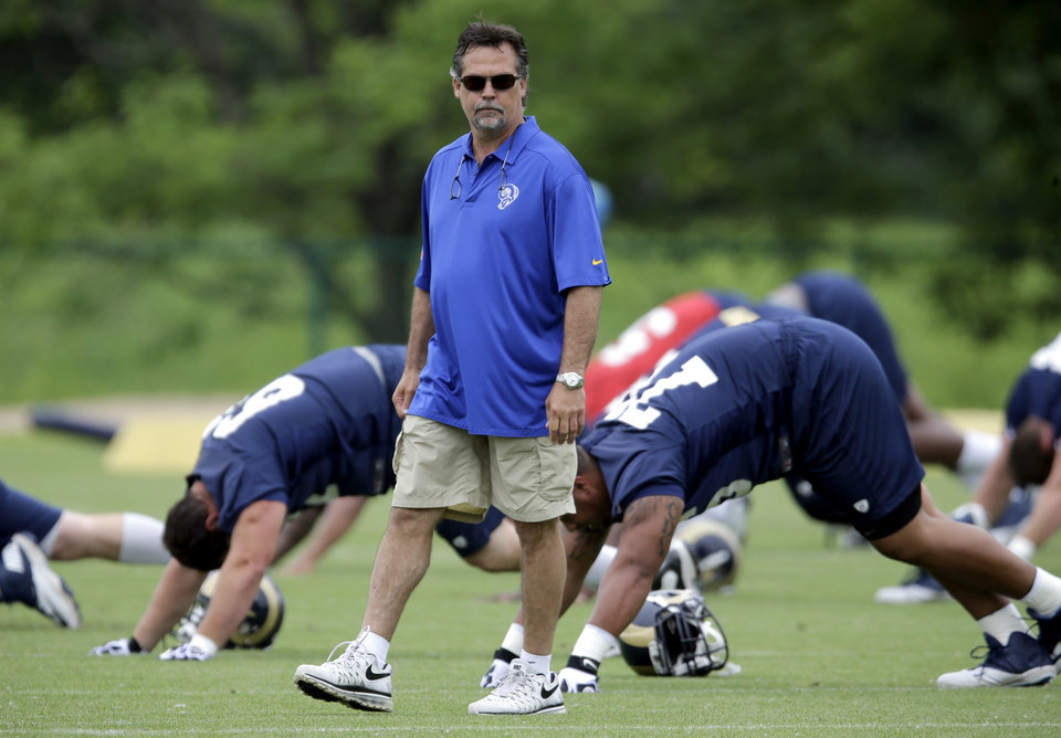 Photo - St. Louis Rams head coach Jeff Fisher watches his team during an organized team activity at the NFL football team's practice facility Thursday, June 5, 2014, in St. Louis. (AP Photo/Jeff Roberson)