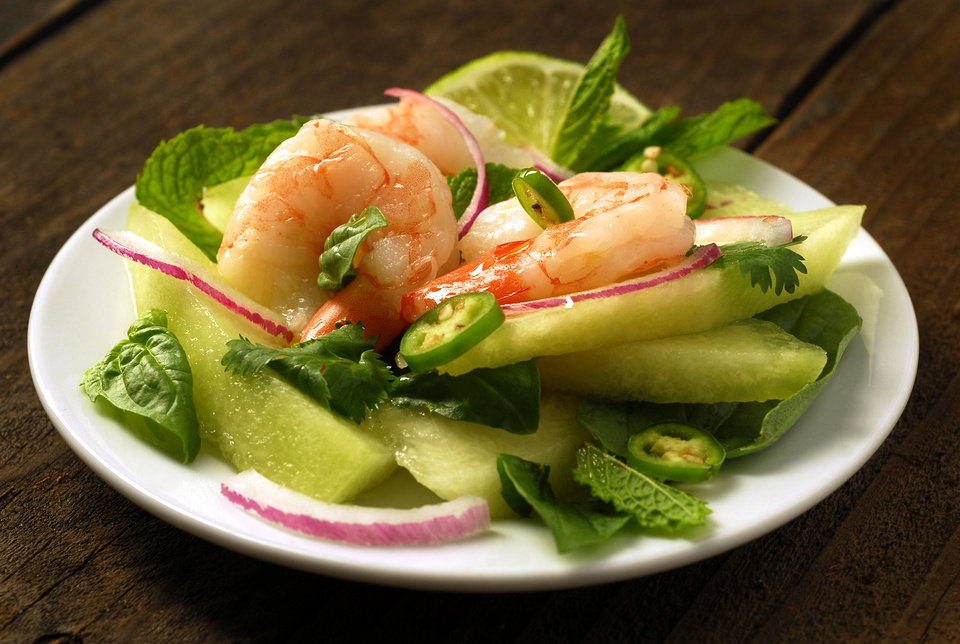 Melons are a staple of summer, but you can add a bit of heat with some spice to compliment the cool melon. This is green melon with Vietnamese shrimp. ( <strong>MARK DuFRENE - MCT</strong>