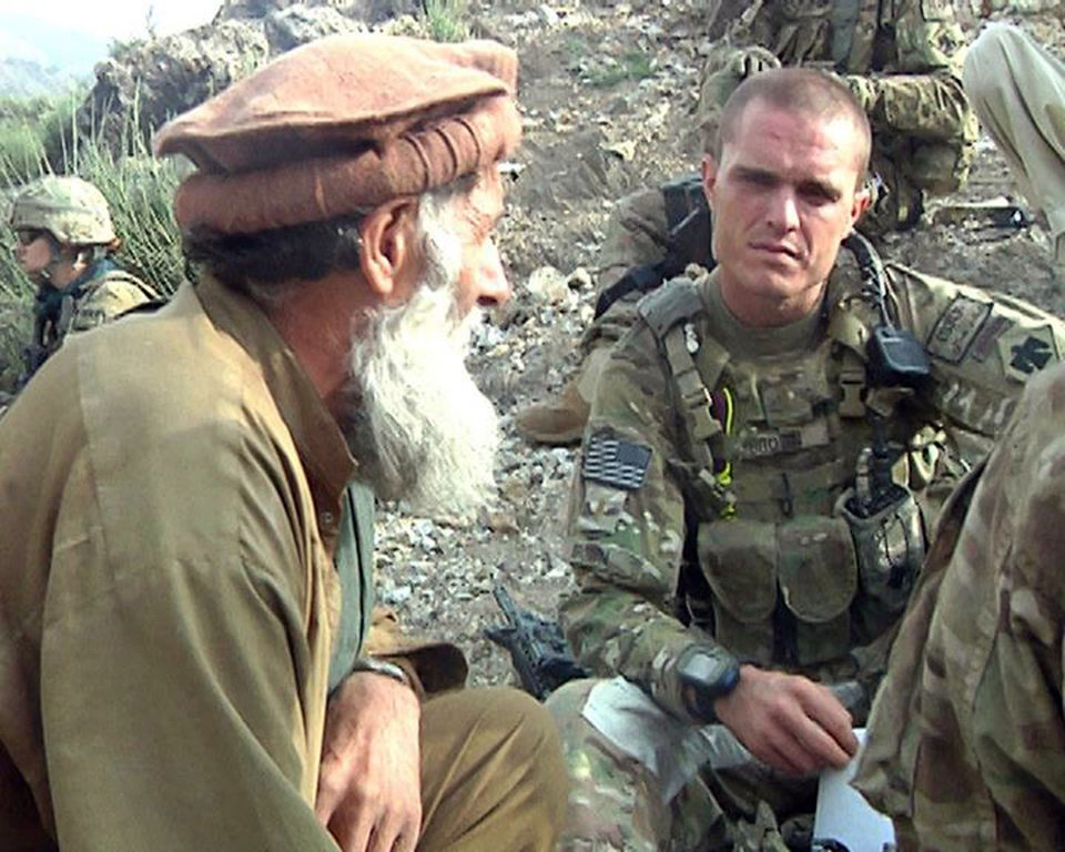 Second Lt. James Brown of Binger, Okla., conducts a shura with elders in the Saygal Valley during clearance operation Brass Monkey, Sept. 15. The operation marked the first time in eight years a sizable coalition force had ventured deep into the Afghan valley' considered a Taliban haven. PHOTO: Spc. Tanangachi Mfuni. 7th Mobile Public Affairs Detachment