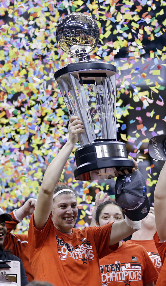 Photo - Nebraska forward Jordan Hooper hoist the championship trophy after defeating Iowa in an NCAA college basketball game in the finals of the Big Ten women's tournament in Indianapolis, Sunday, March 9, 2014. Nebraska won 72-65. (AP Photo/Michael Conroy)