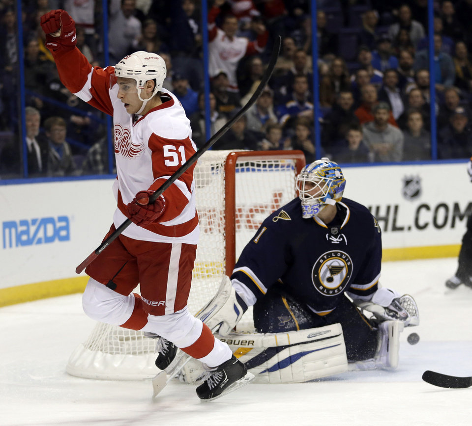 Detroit Red Wings' Valtteri Filppula, of Finland, celebrates after scoring past St. Louis Blues goalie Brian Elliott during the third period of an NHL hockey game Thursday, Feb. 7, 2013, in St. Louis. Detroit won 5-1. (AP Photo/Jeff Roberson)
