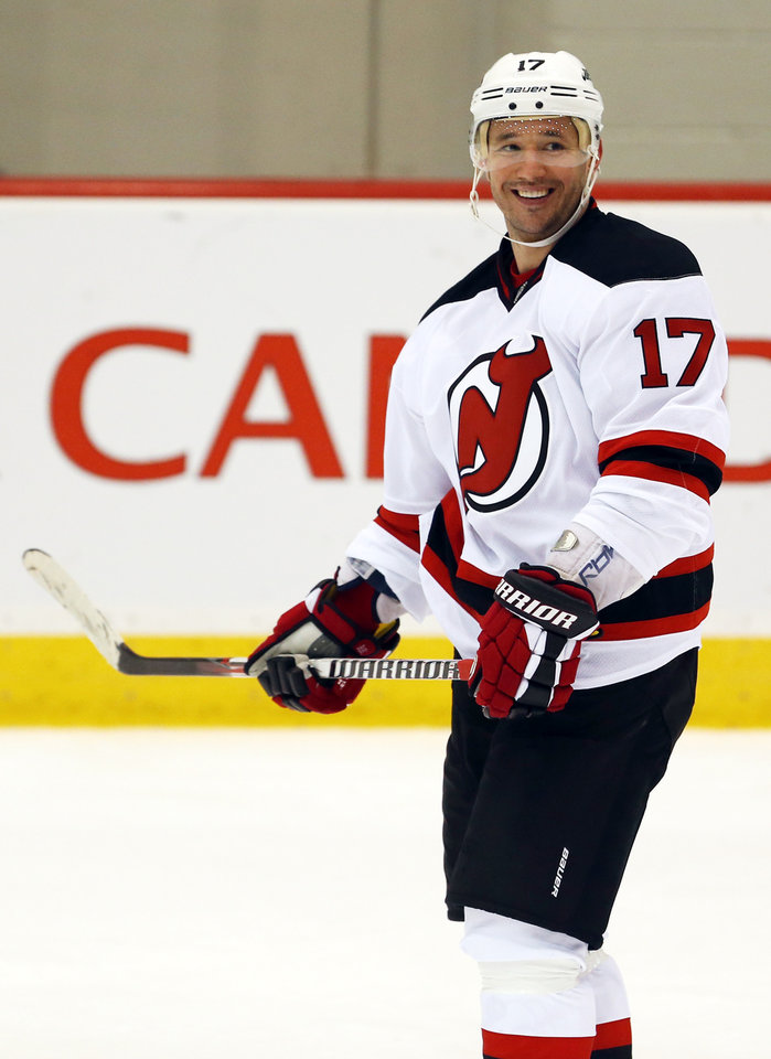Photo - New Jersey Devils left wing Ilya Kovalchuk, of Russia, reacts after scoring a goal during a scrimmage against the Albany Devils, the team's AHL farm team, Wednesday, Jan. 16, 2013, in Newark, N.J. (AP Photo/Julio Cortez)