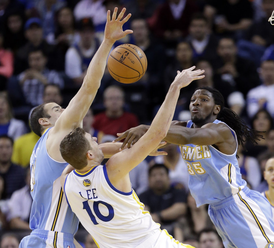 Denver Nuggets' Kenneth Faried (35) blocks a shot attempt from Golden State Warriors' David Lee (10) during the first half of an NBA basketball game in Oakland, Calif., Thursday, Nov. 29, 2012. (AP Photo/Marcio Jose Sanchez)